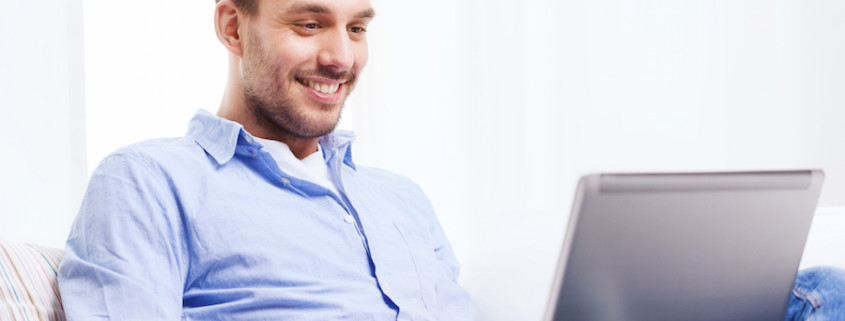 man using live chat with laptop at home
